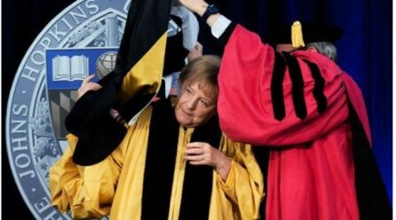 German Chancellor gets entangled in gown while taking honorary degree, video goes viral